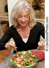 Healthy Eating For Fitness - A beautiful fit woman in her...