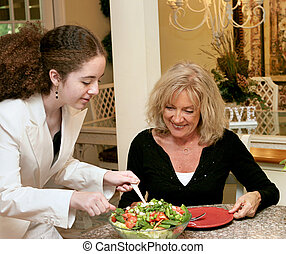 Healthy Eating Habits - A teen girl and a mature woman...
