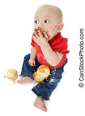 Baby Eating Cake - Baby eating cake, making mess on face.