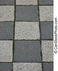 Tiled pavement in grey black and white shades