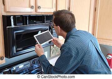Handy Man Home Repair - Man replacing the filter in a...