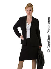business woman with hand on hip carrying briefcase standing...