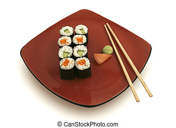 Sushi rolls on red plate with ginger and wasabi