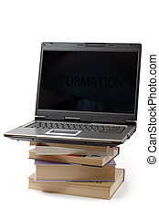 Laptop 4a - Laptop standing on pile of books information...