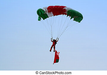 Parachuting - A parachutist gliding down towards the drop...