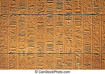 Hieroglyphics on the wall in the Temple of Philae at Aswan,...