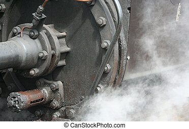 steam - Steam coming out underneath of a steamtrain