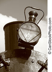 steam - detail of steam train: exhaust with lamp. Sepia...