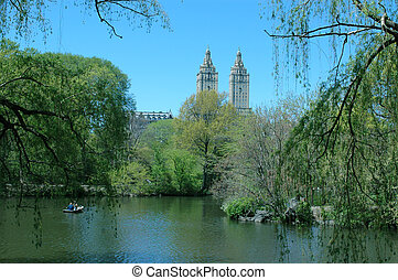 art deco building - view from central park lake new york...