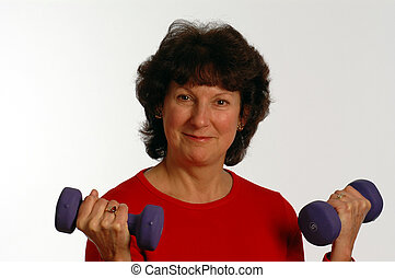 beautiful woman in fitness gym - working with dumbbells