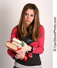 College girl - College age woman carrying a handful of books