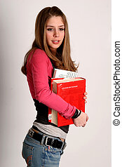 Off to study - Pretty young college-age woman carrying...