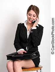 Good news - Pretty young woman in business attire with...