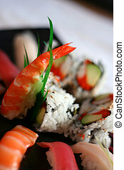 Assorted Sushi - A variety of sushi and nigiri encircling a...