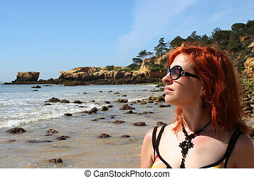 beach babe 4 - woman soaks up the sun at the beach in the...