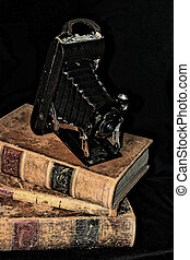 Antique Media - Century old camera resting on top of 150...