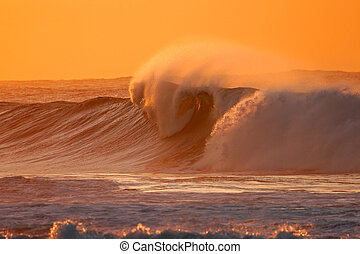 Breaking wave - Seascape at sunset with large breaking wave
