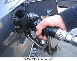 Filling diesel - Closeup of man\\\'s hand filling diesel