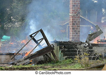 Controlled burn - The burning of an abandoned house.