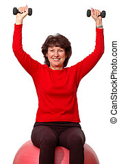 fitness time - smiling woman using weights for fitness
