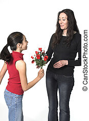 mothers day - daughter offering flowers to her mother...