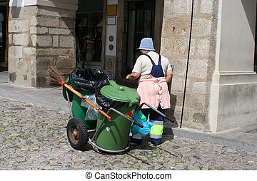 street cleaner in Evora, Portugal