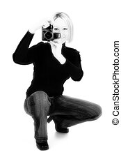Woman with Camera - Young woman with digital camera in black...