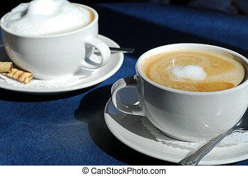 Cappuccino and Latte in cups with saucers