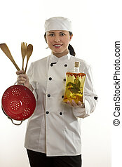 Kitchenhand or chef holding utensils