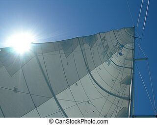 Sun and sail - A sailboat mast from below with the sun...