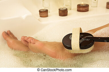 Woman #65 - Bare feet in a bubble bath