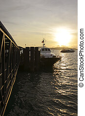 Ferry Terminal-Vertical - Passenger ferry docked at the...