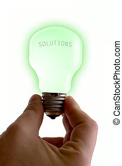 Bright Solutions - Concept : bright idea. Green lit bulb...