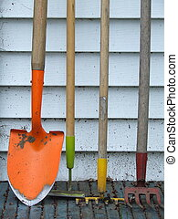 Garden tools against a wall