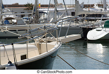 sitges boat - boats moored in the harbour of sitges, near...