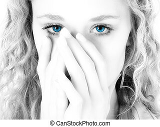 Blue Eyes - Close-up of a beautiful blonde woman covering...