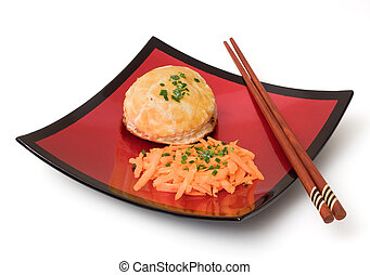 Asian meal - Asian meat pie and carrots in a red lacquered...