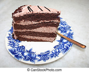 Chocolate cake - A slice of chocolate cake with icing