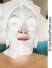 Facial Mask - A detail of a facial mask being applied at a...