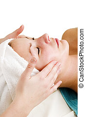 Face Massage at Spa - A face massage during a facial at a...