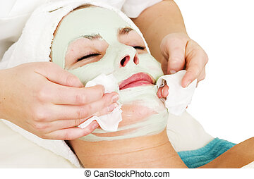 Facial Mask Detail - Detail of a facial mask treatment being...