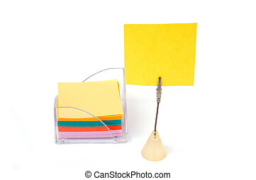 Blank note on stand with stack of notes in holder -look in...
