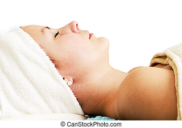 Beauty Spa Facial - Relaxing during a facial treatment at a...