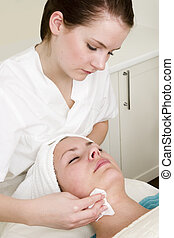 Beauty Spa Facial - Lotion being wiped off during a facial...