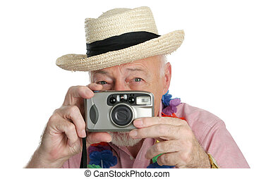 Senior Shutterbug - A senior man on vacation snaping...