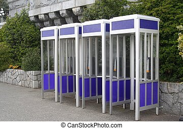 Blue Phone Booths - A row of four identical phone booths