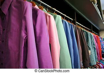 Silk suits - Rows of colored silk suits hanging on a shop...