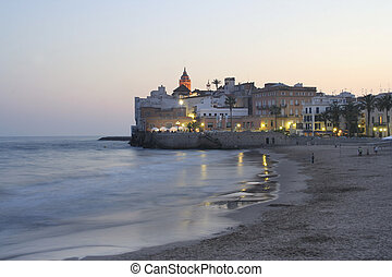 sitges church view - coastal view and the church at dusk in...