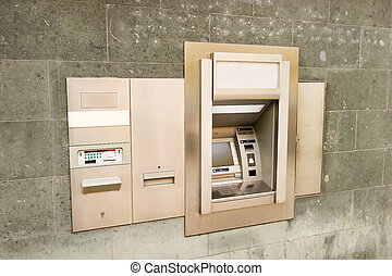 Bank Machine - A bank machine on a stone wall.