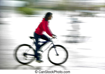 riding a bike - Girl riding is bike in motion effect